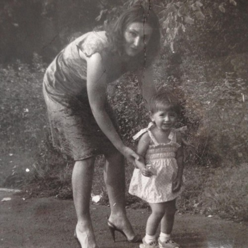 Karolina Wydra with mother childhood image